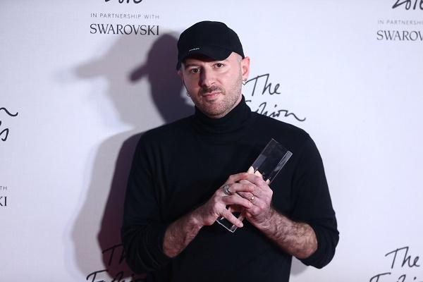 Demna Gvasalia, winner of the International Urban Luxury Brand award poses for photographers at the Fashion Awards 2016 in London